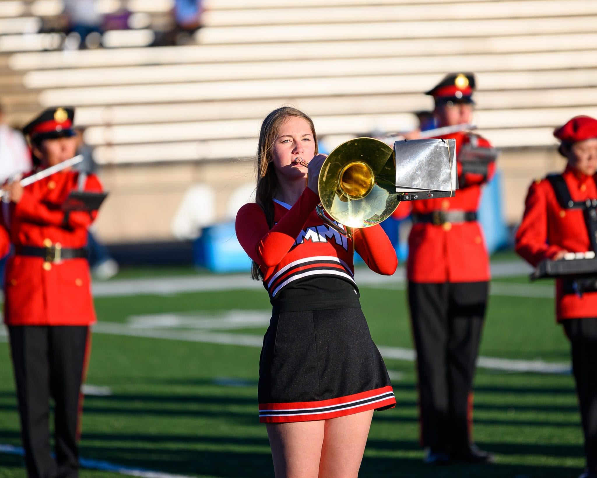cheerleader playing trumpet